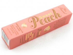 too faced creamy peach oil lip gloss in peach-sicle