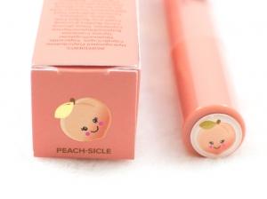 too faced creamy peach oil lip gloss in peach-sicle